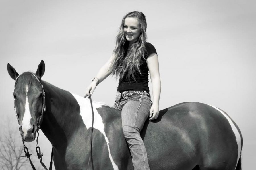 Addison+Donnell+enjoys+riding+her+horses.+She+received+a+full+ride+to+the+University+of+Florida+to+be+on+an+equestrain+team.+