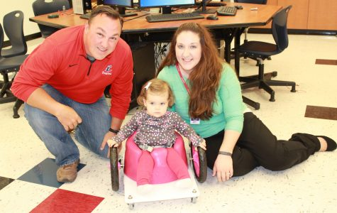 Mr. Redman, Faith, and Mrs. Willis celebrate the successful creation of the custom built wheelchair.