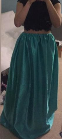 Claire Hughey shows off the skirt that took her five hours to make for prom.