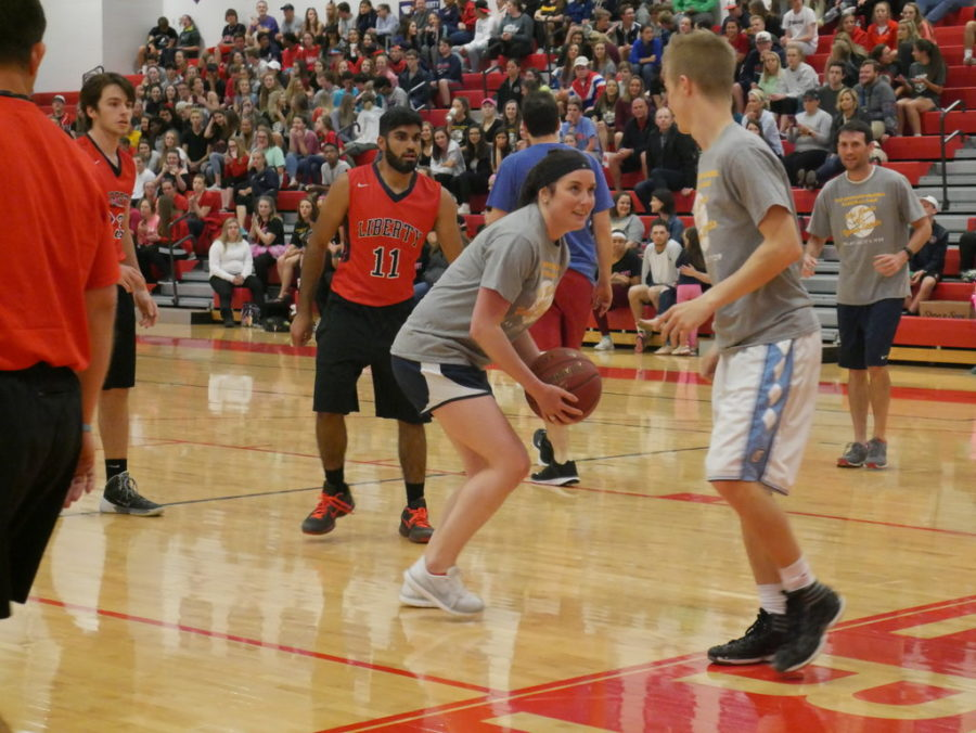 Mrs.+Sutherlin+steals++the+ball+from+Mr.+Luedecke