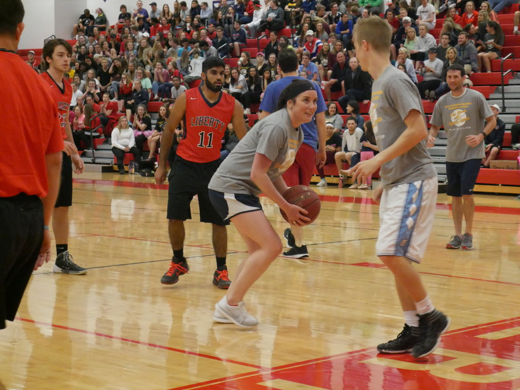 Mrs. Sutherlin steals  the ball from Mr. Luedecke