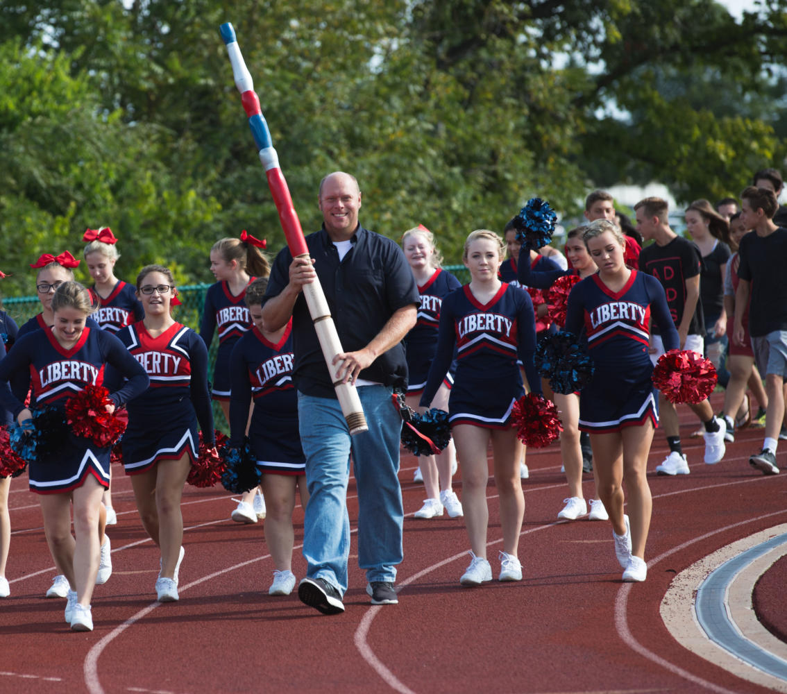 Mr. Wheeler proudly holds the spirit stick while leading the new students on their first day of school. Wheeler's contagious outlook on life and attitude brings joy to so many.