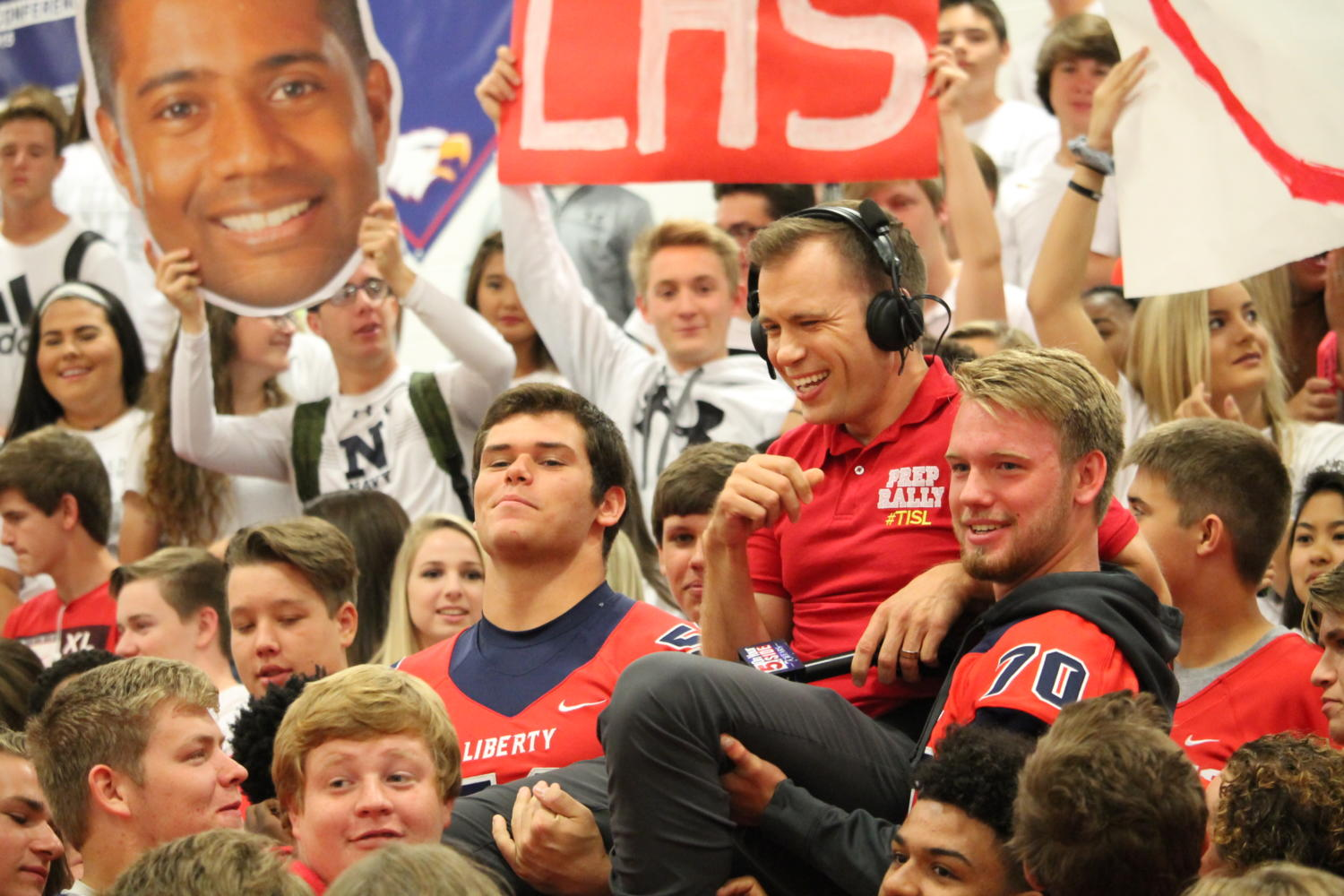 Seniors+Brandon+Wortman+and+Justin+Holmes+carry+KSDK+reporter+Ryan+Dean+during+the+prep+assembly.