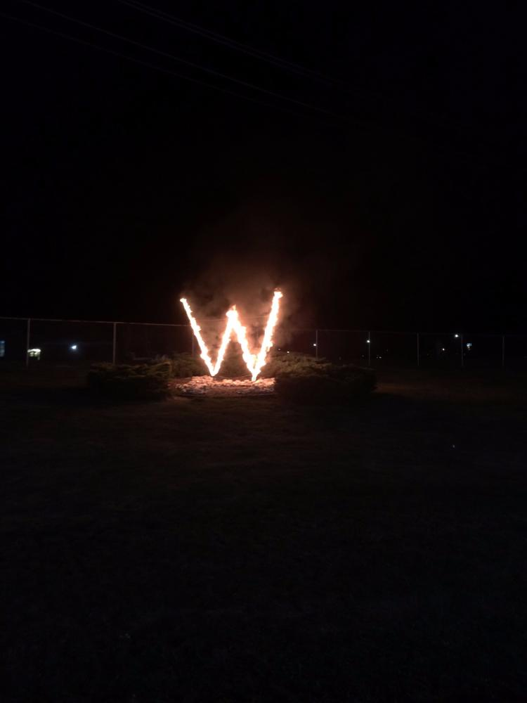 The W symbolizes a victory and encouragement  for Holt.