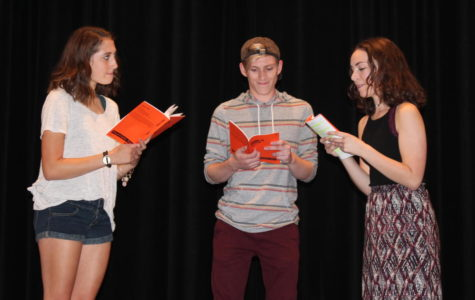 Julia Deters, Braden McMakin and Eleanor McCrary read their lines at practice.