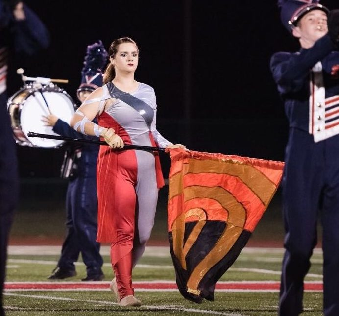 Allison Holtschlag performing the half time routine for color guard (submitted by Allison Holtschlag)
