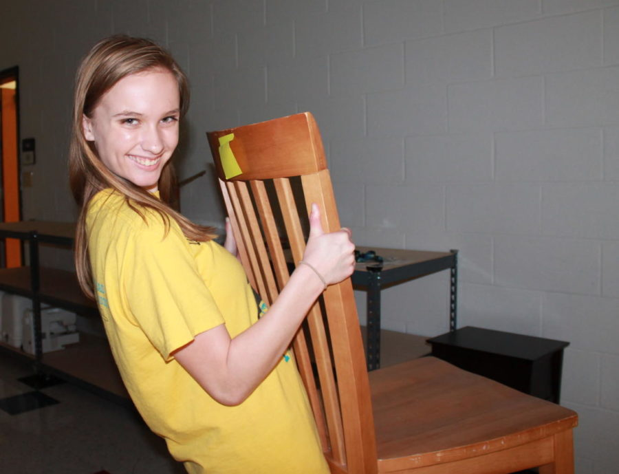 Sophomore Audrie Helms supports the production by helping with the stage props.