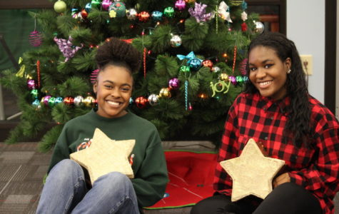 Junior Aria Ellis and senior Hannah McCrary show their holiday spirit. The students both agree that gifts should be thoughtful and come from the heart.