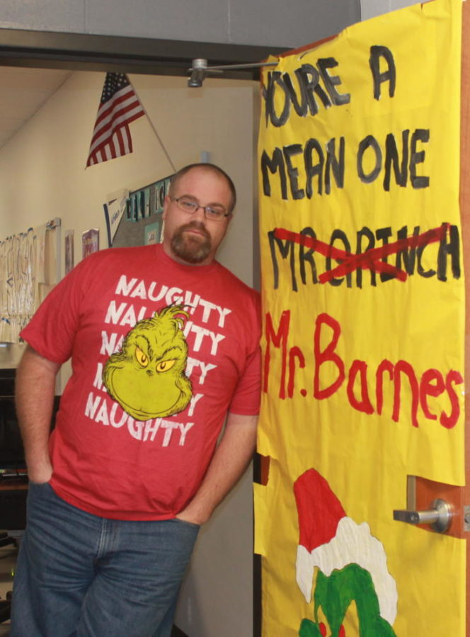 Mr. Barnes stands next to his Grinch-themed personality door.