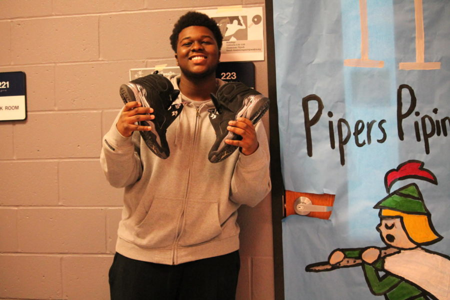 """Junior Sha'Kir Martin-Watson chose his outfit because it went with his shoes. """"I always start with the shoes and up,"""" said Martin-Watson. He usually chooses his outfits the day before."""