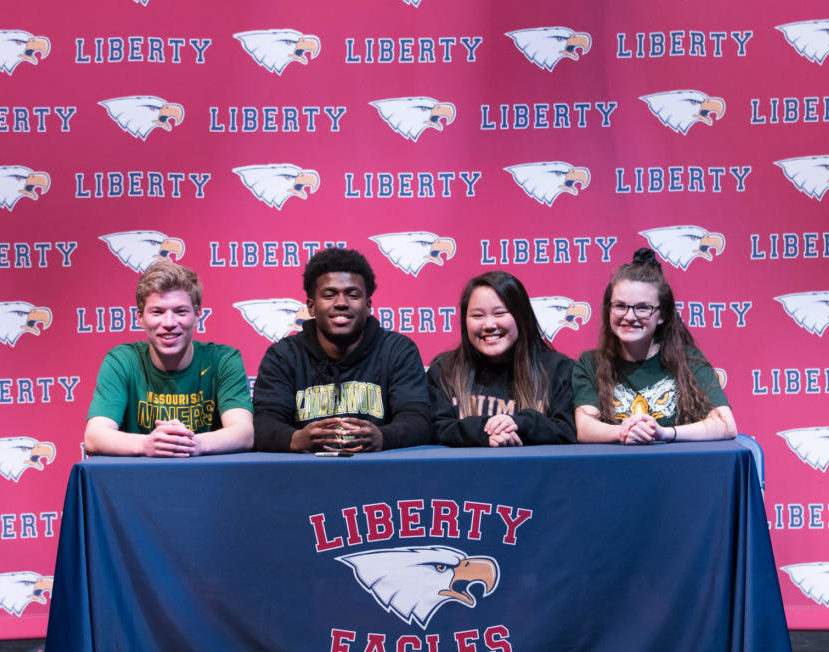 From left to right: Seniors Lucas Mitchell, Wesley Hines, Maya Schnable and Claire Roberts gather to celebrate the start of their college sports careers on National Signing Day, Wednesday, February 7th.