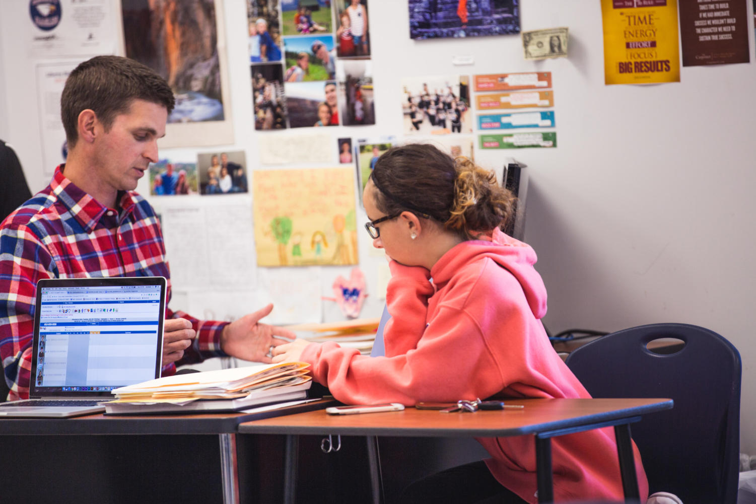 Mr. Hall discusses story planning for the Ledger magazine with co-editor-in-chief of the magazine junior Olivia Holler.
