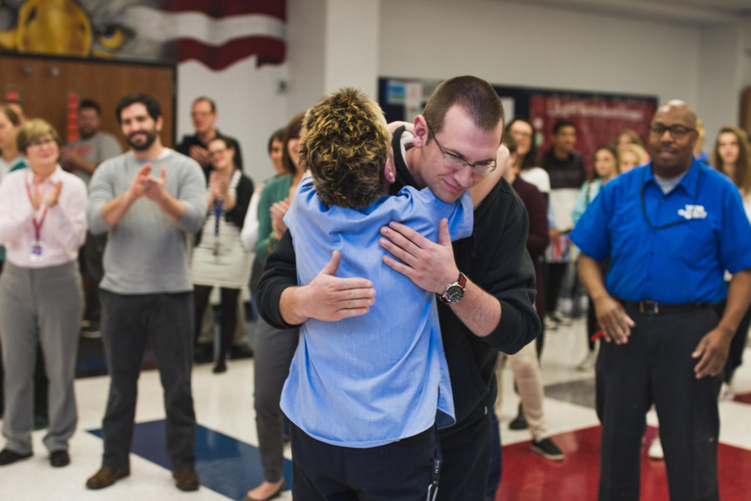 Mr. Boswell proudly hugs his mom after accepting his award. Both of the Boswells had no idea that Mr. Boswell would win the award, which made the surprise that much better.