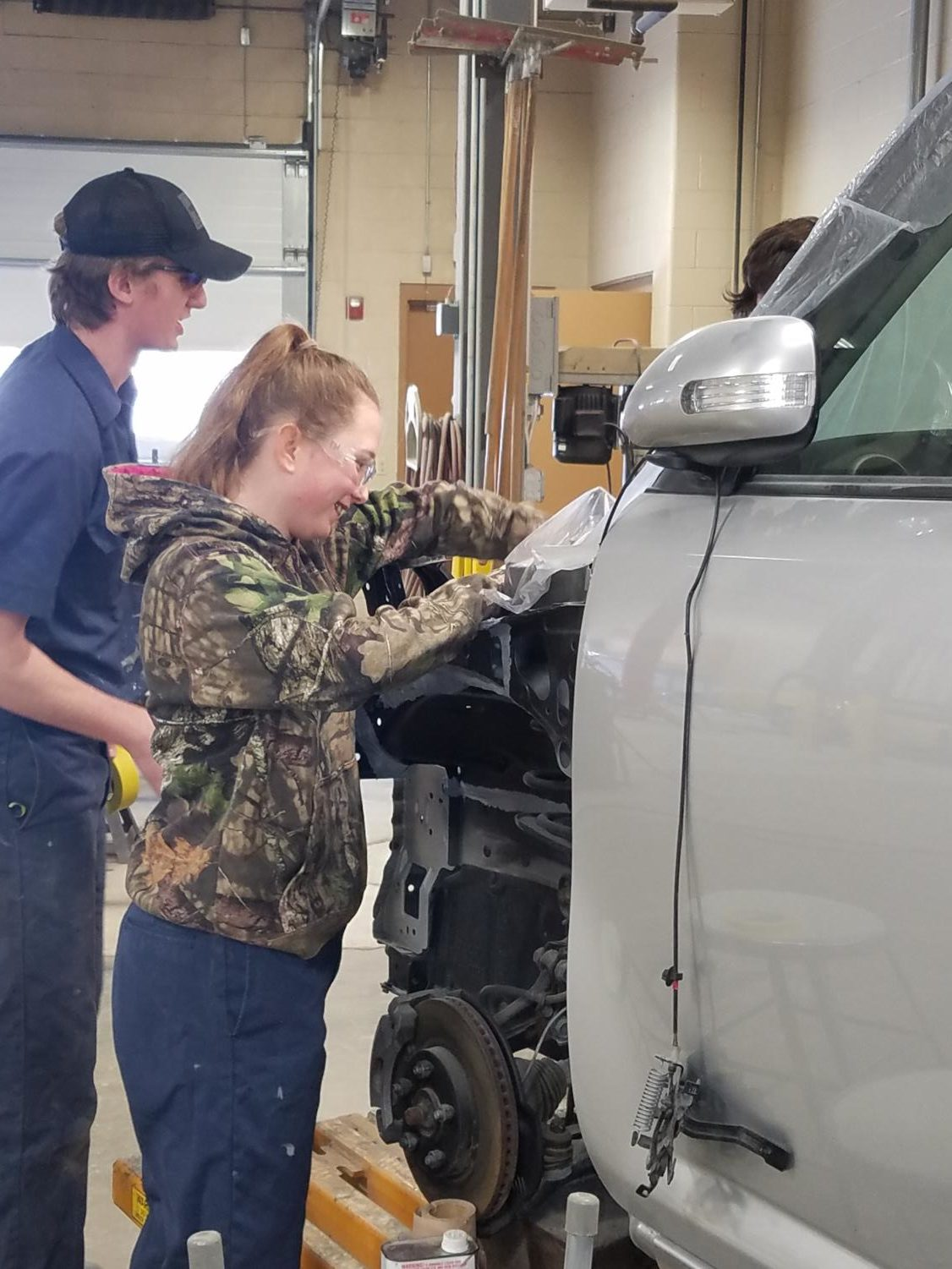 Molly Smart, senior at Liberty, shows her knowledge in Collision Repair.