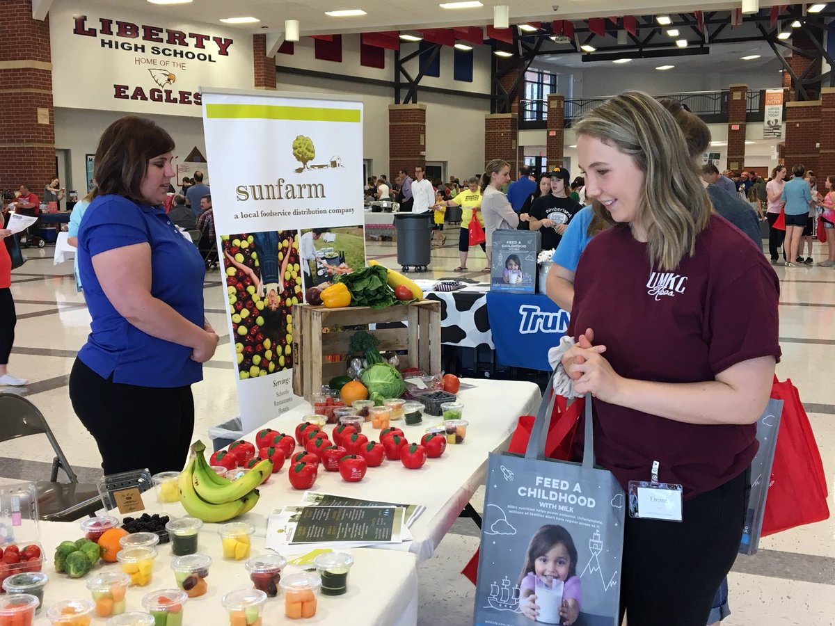 A guest samples some free finger foods at a table during the Food Expo on May 5.