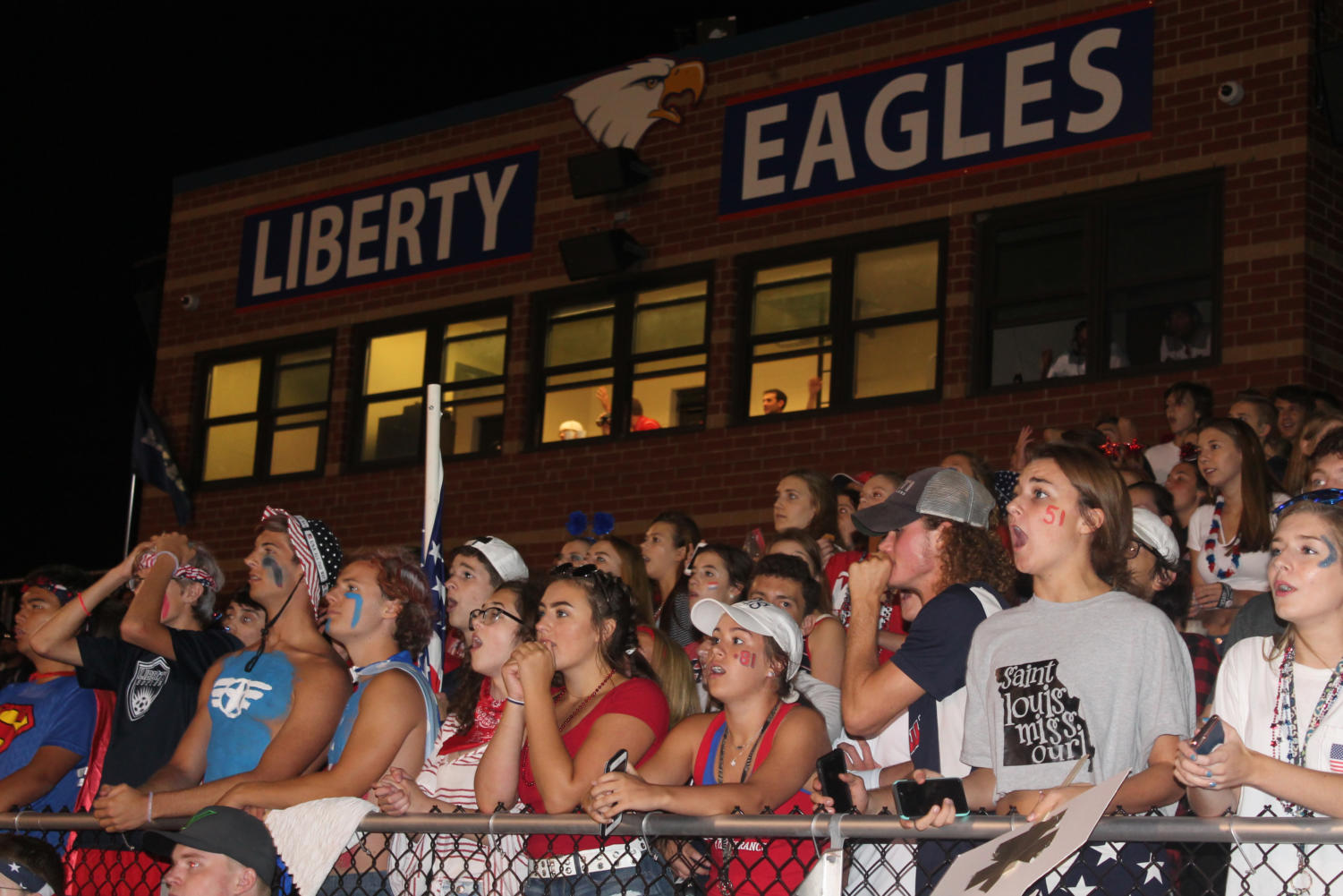 After Warrenton rallied late in the fourth quarter to make it a one possession game, the student section anticipates a close finish. A defensive stop in the closing minute sealed the Eagles 20-13 victory.