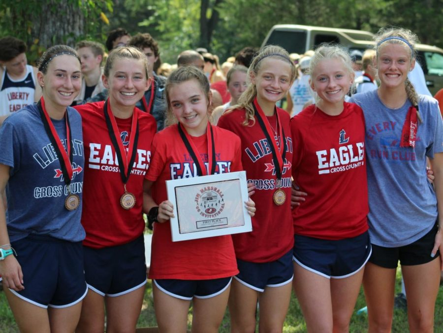 Cross+country%27s+varsity+girls+celebrate+their+first+place+victory+on+their+first+meet+of+the+season.