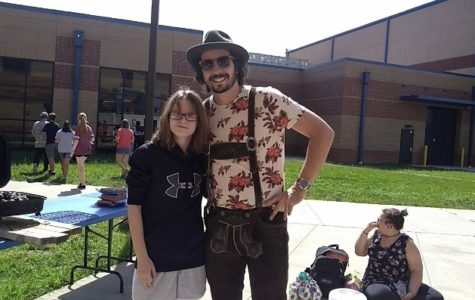 Emily Pisell is involved in multiple extracurricular activities. Here she is with Mr. Stoll at German Club.