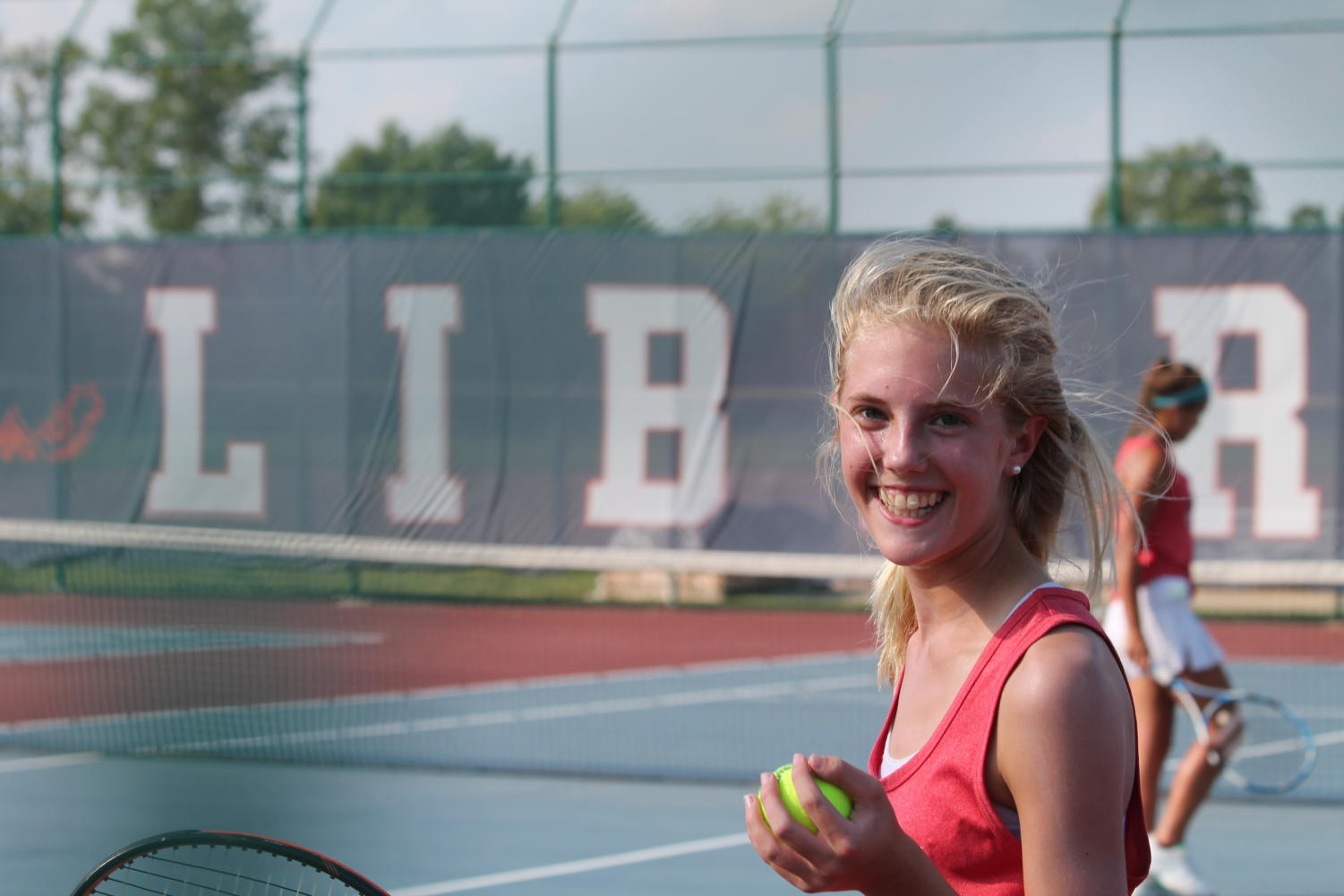 Carly Torbit prepares for her doubles match against Holt. She is a freshman on varsity tennis.