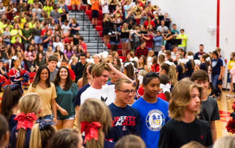 Freshmen are excited to enter the gym on the first day of school.