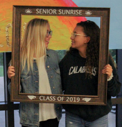 Left to right: Seniors Jaeda Lee and Savana Wiegand pose for the Senior Sunrise. It's help bonded the seniors together and realize the amazing times that Liberty has given them.