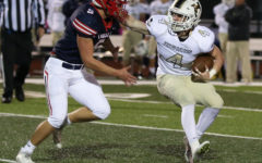 Grant Baker rushes  the Holt running back. Liberty hosts Francis Howell North on Friday.