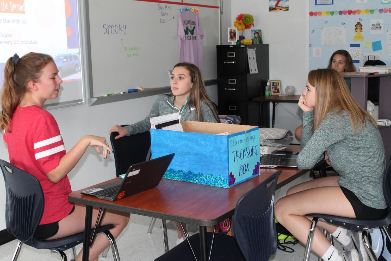 Educators Rising members Katie May, Halle Green and Megan Kruse discuss future plans.