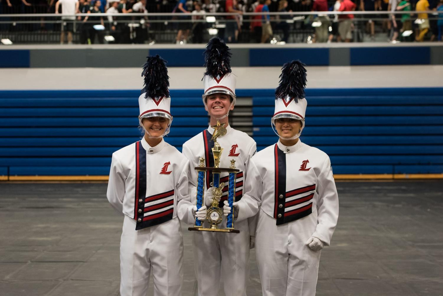 Band majors Lydia Hart, Luke Carter and  Elaine Amery hold the third place trophy.