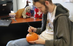 Senior Ian Beardslee paints his pumpkin in German Club.