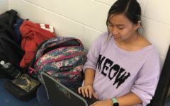 Chynna Yeh works on her writing while on a break during musical rehearsal.