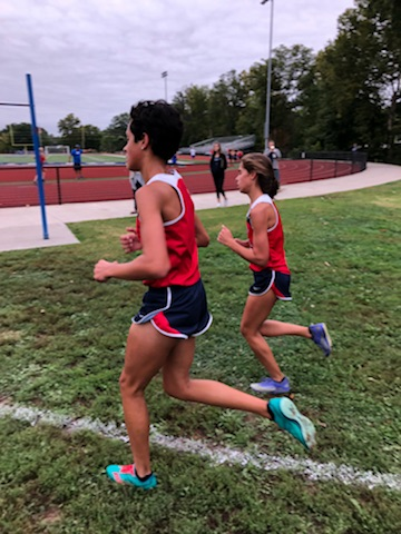 Adrienne Rockette and Megan Venturella compete at the conference meet at Washington.