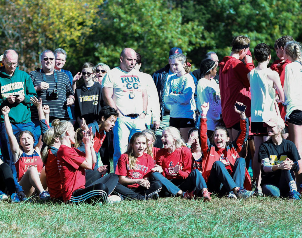The cross country team reacts moments after learning they advanced to the state meet.