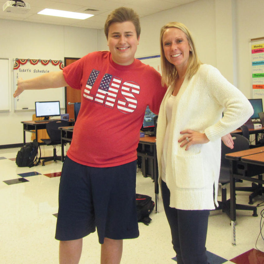 Sophomore Andrew Taylor and Ms. Muench pose for Taylor's 7th hr picture for his 'Day in the Life' project.