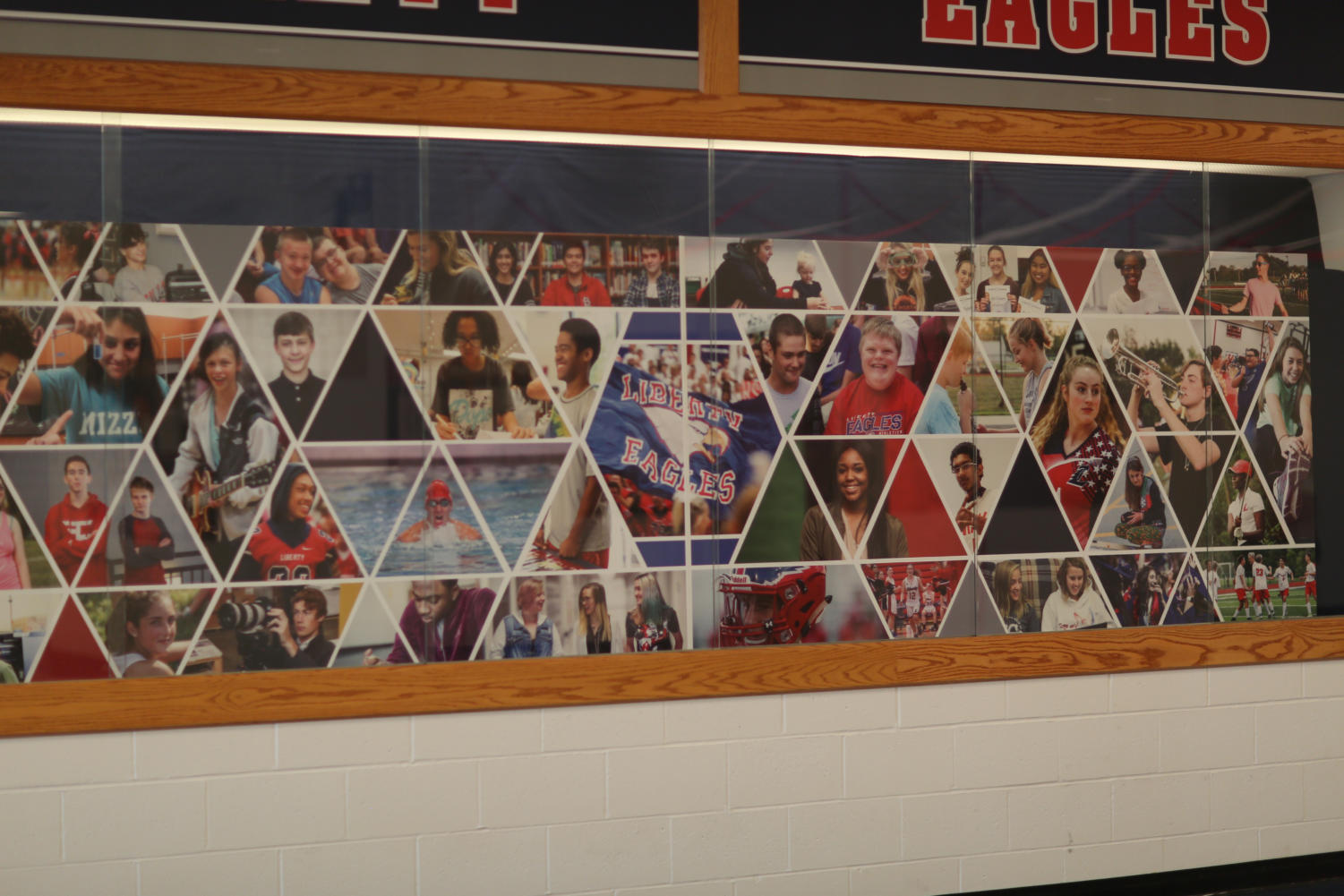 The new photo display exhibits students from various clubs and organizations.
