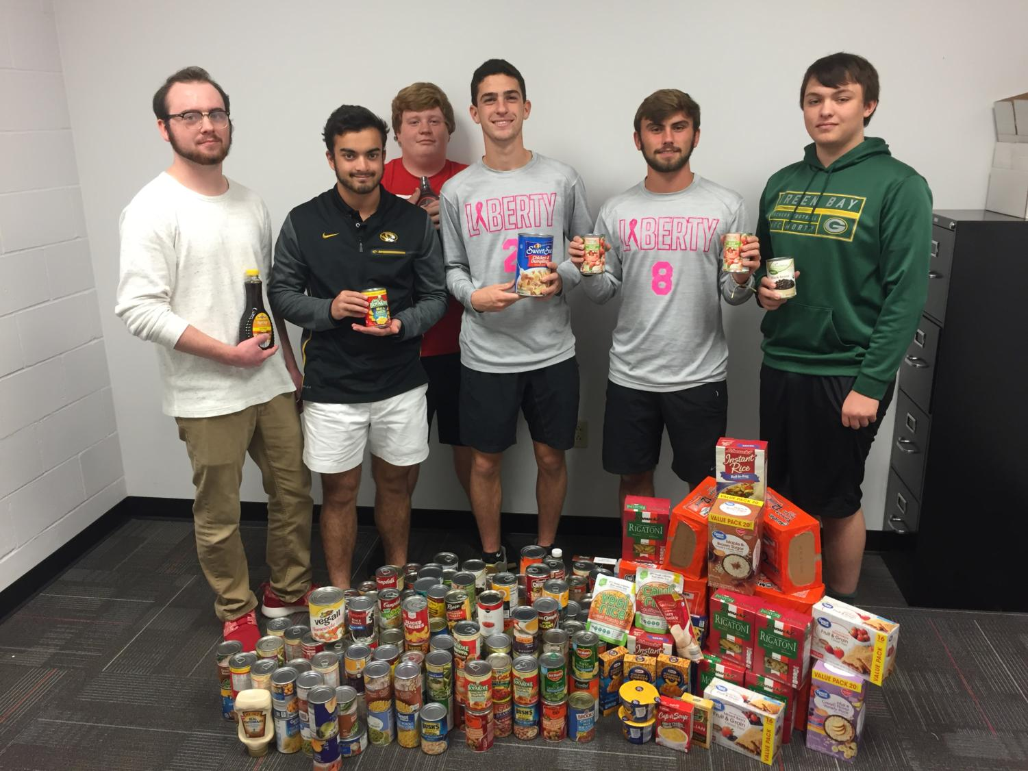 The Advanced Marketing 2 class gathers the cans that students have donated.