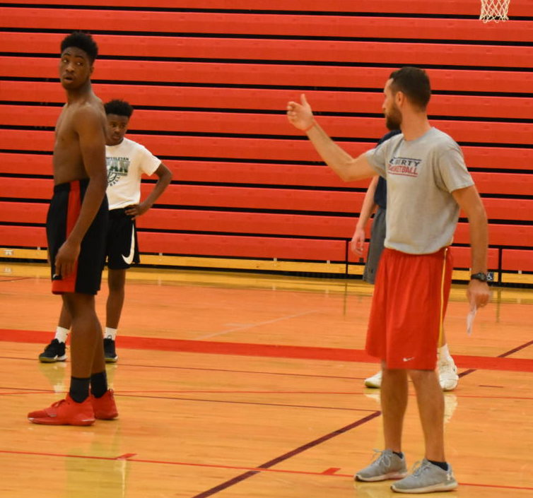 Coach Sodemann explains a drill to senior Kent Lawson and sophomore Gabe McCrary.