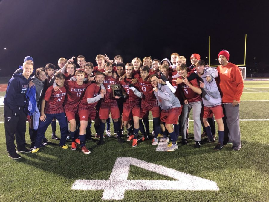 The+varsity+boys+soccer+team+celebrates+its+district+championship+moments+after+defeating+Borgia+5-0+on+Thursday+night.