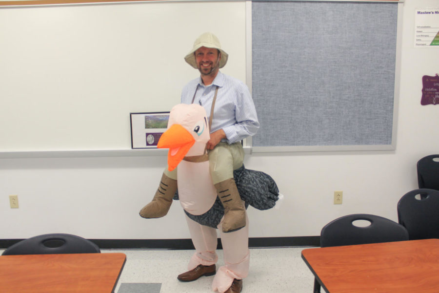 Mr. Barker poses in his costume chosen by the students. The proceeds from the costume contest will go towards Trick-or-Treating for UNICEF 2018.