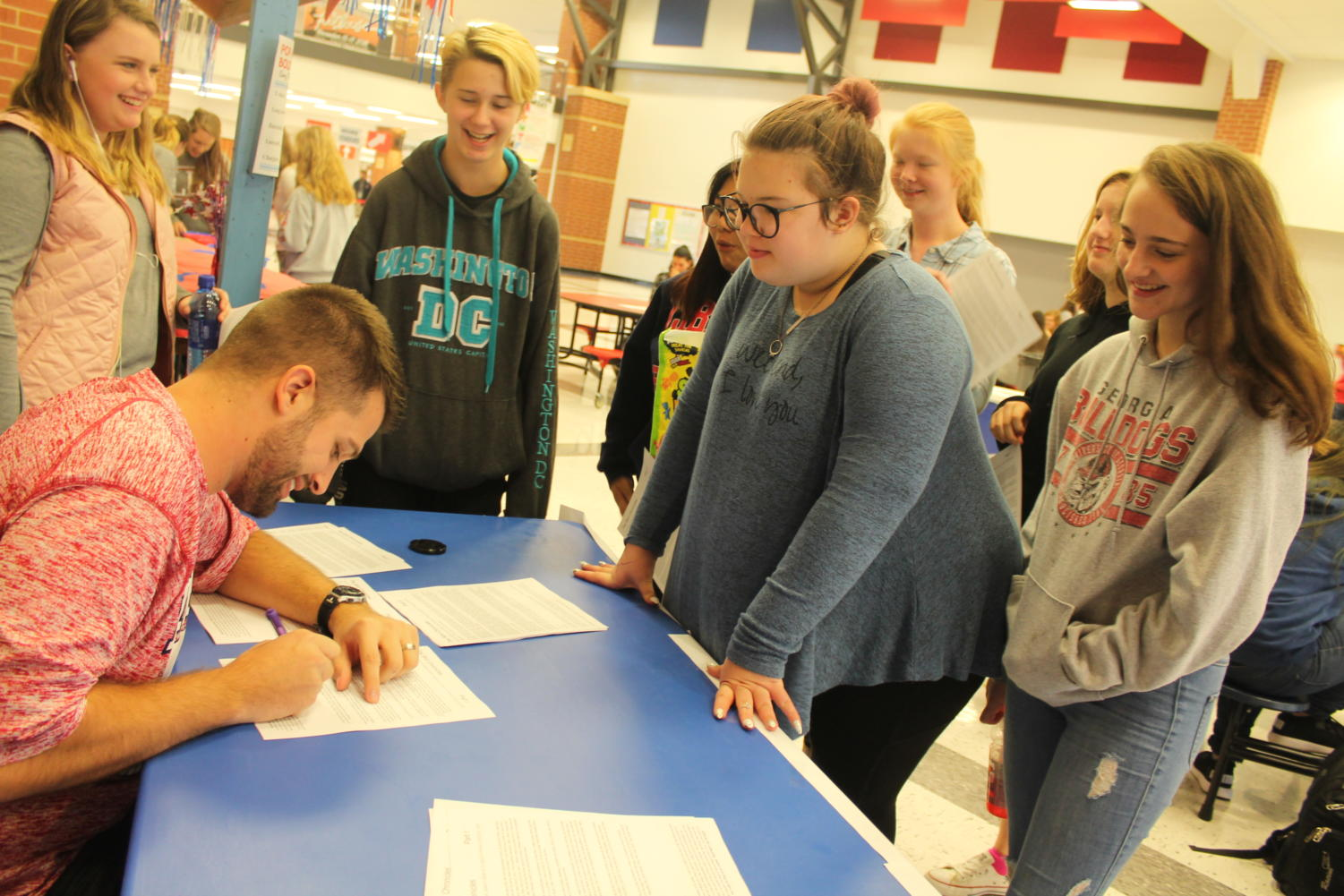 Olivia Overton and Kiersten Baumgartner lined up for an autograph from Mr. Schaper's turkey campaign.