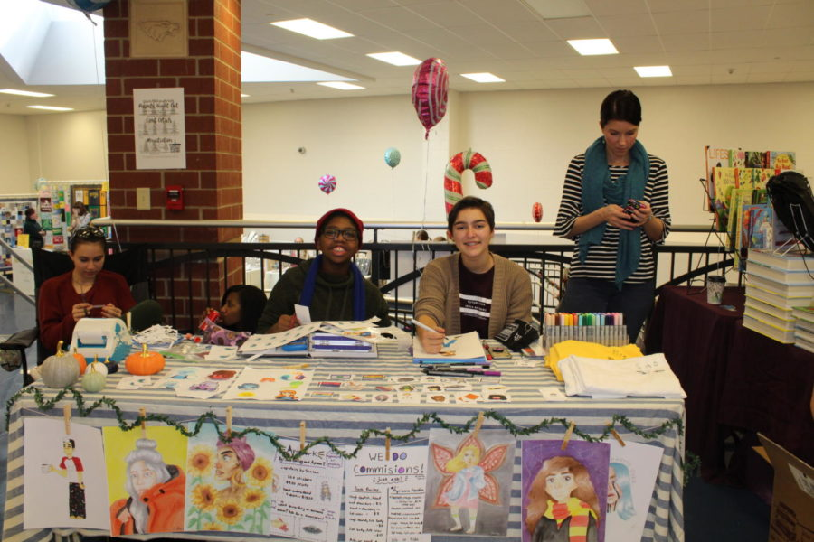Ayrianna Franklin (left) and Sara Bailey (right) are shown selling their art at the Holiday Bazaar on Nov. 10.