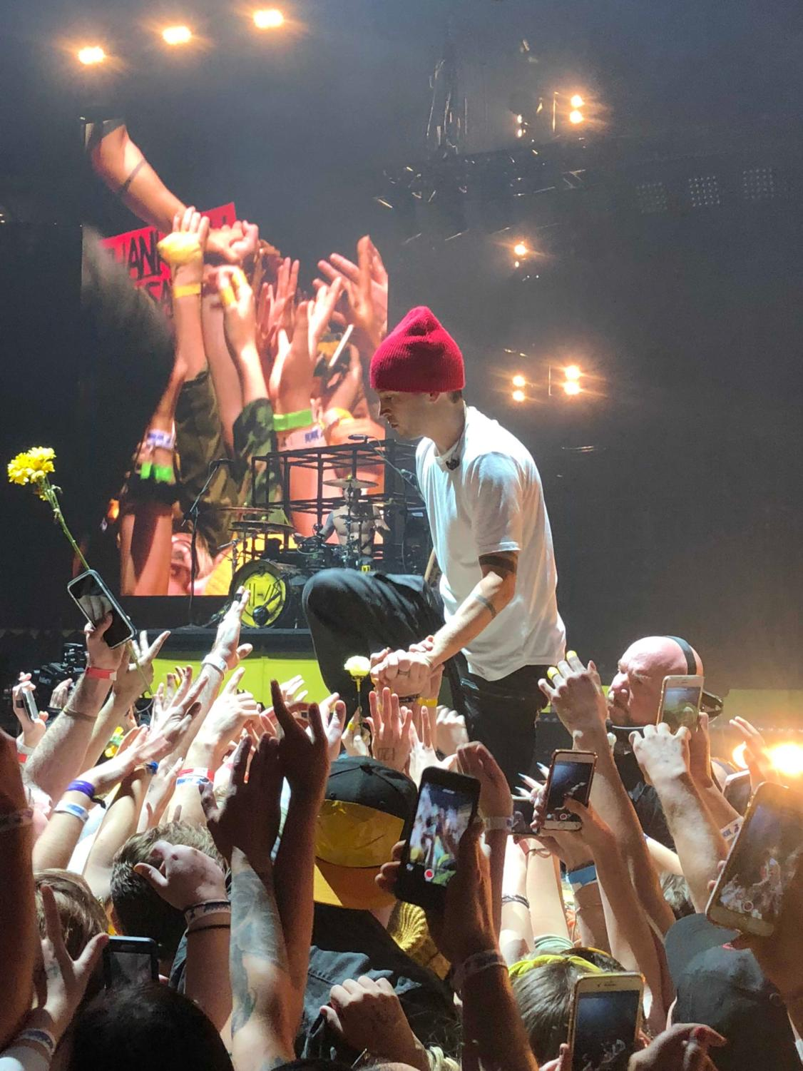 Tyler Joseph being supported by fans while singing the song Ride during the 2018 St. Louis concert.