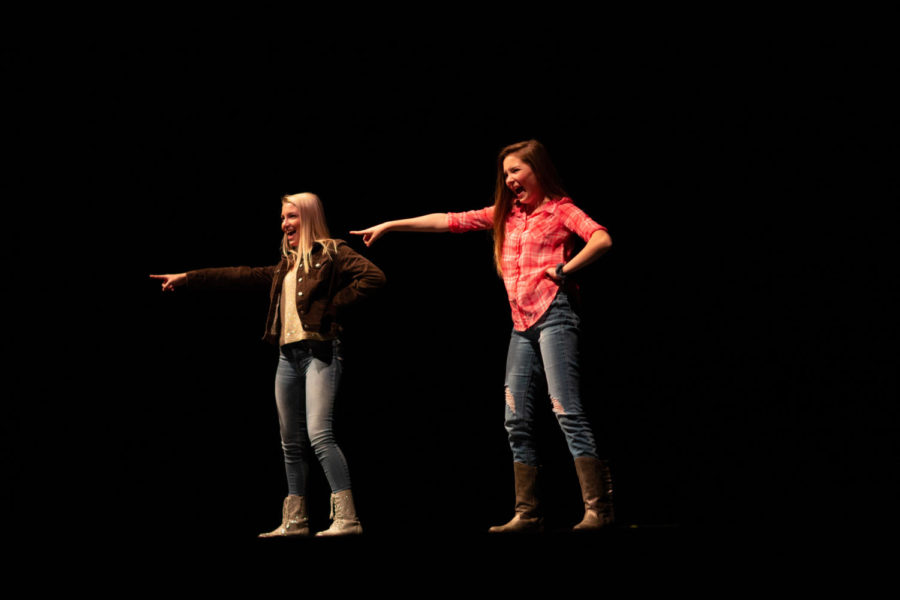 """Sisters Morgan (12) and Jordan (9) Stevens rock out to Hannah Montana as they embody both sides of the superstars life. """"We can be really close sometimes, and other times we fight like siblings do, but all around I love her,"""" said Jordan Stevens in regards to her relationship with her sister. With Jordan as Miley and Morgan playing Hannah, the pair beat Mr. Burthardt."""
