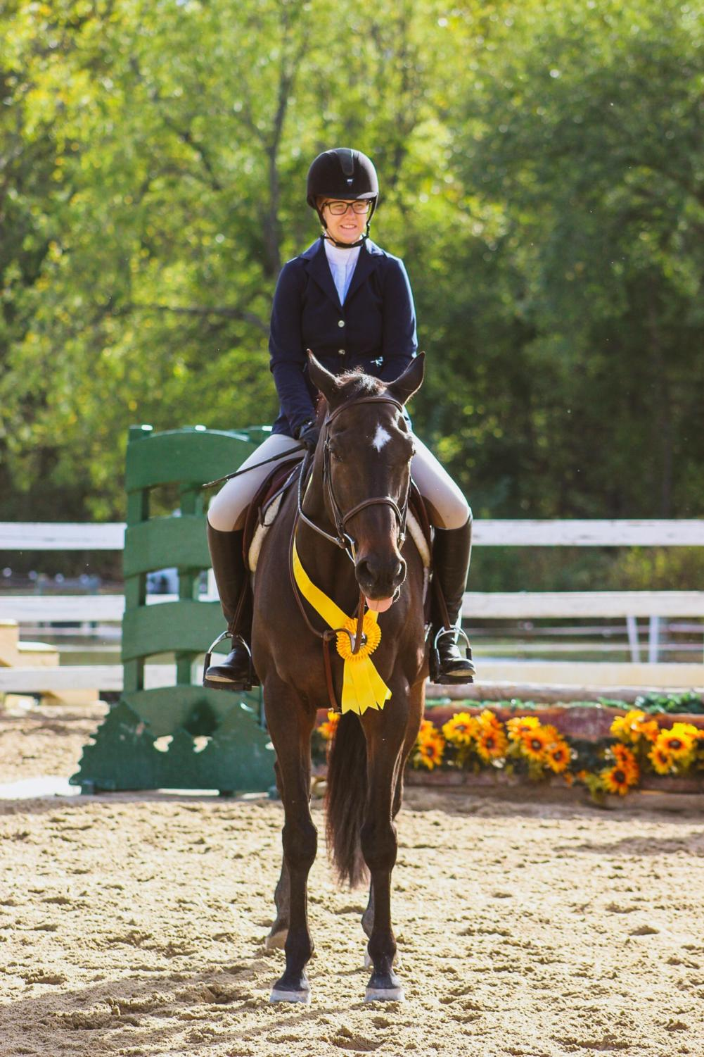 Senior Hannah Gamble with her horse at a show over the 2018 summer.