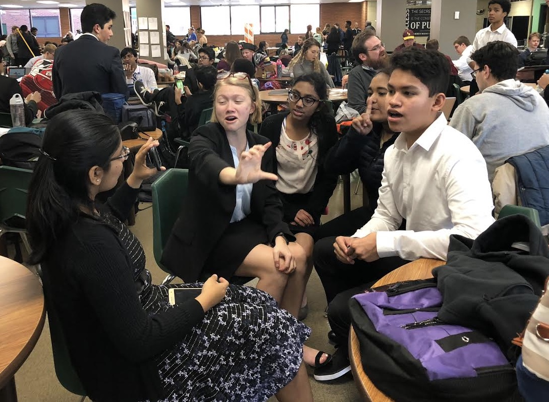 The speech and debate team bonds over their first tournament while waiting for round results.