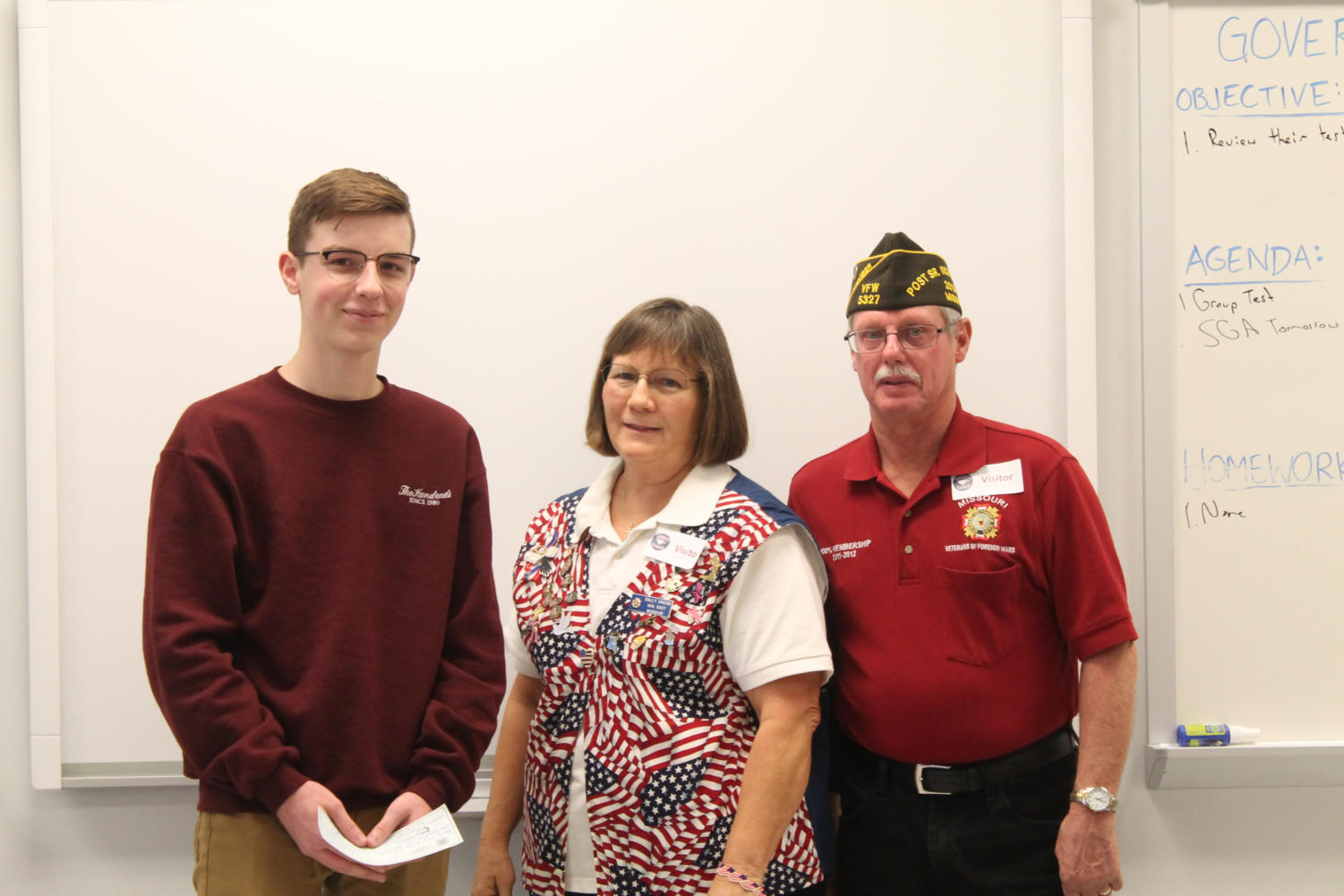 Will Ziegler accepts his Scholarship of $100 from Ron and Sally Owens of the VFW.
