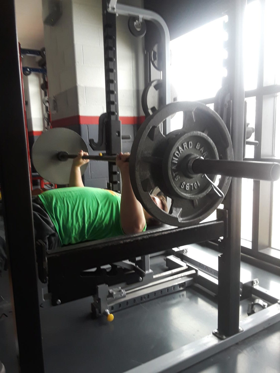 Senior Kevin Roberts works out on the bench press. Weight training is about improving your technique. The coaches teaching this class have had years of experience. They will make sure you know what you are doing.