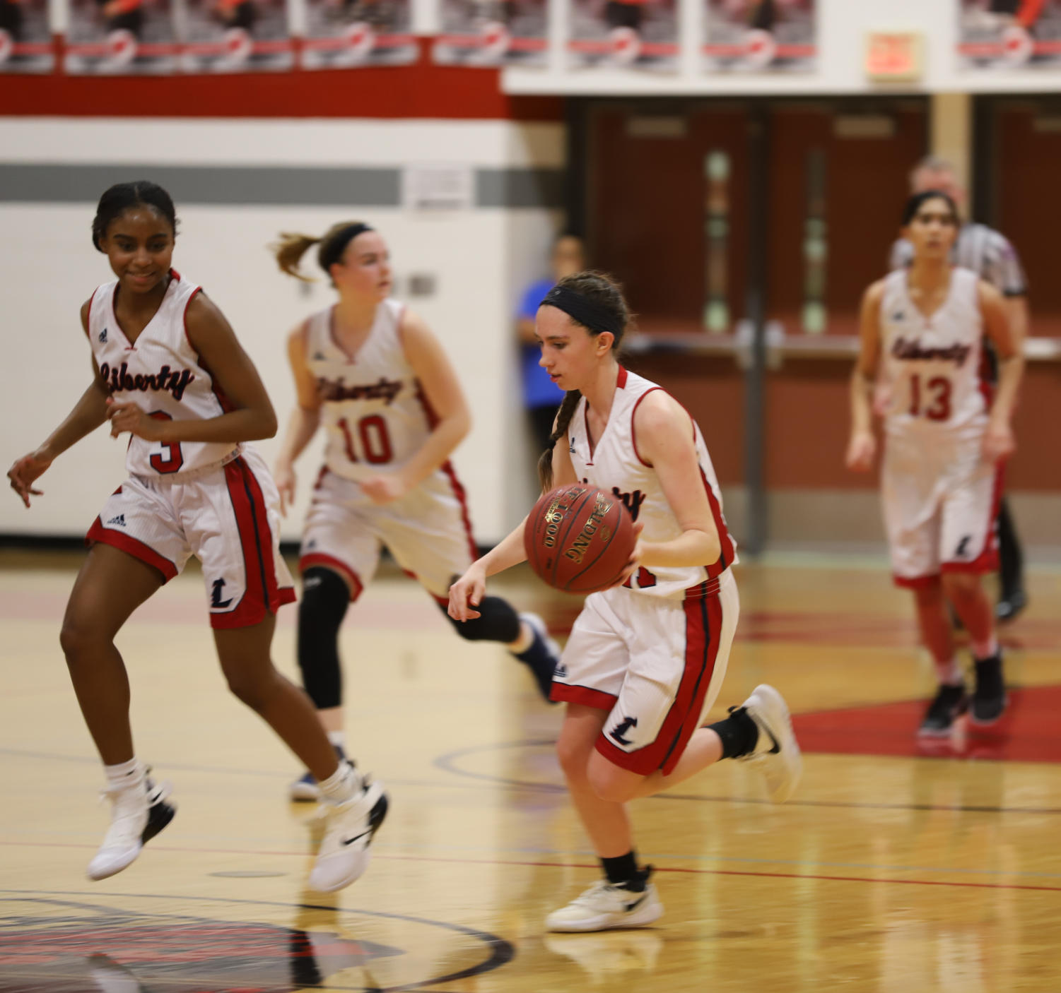 Sara Gordley dribbles down the court in a game at the Warrenton Tournament.