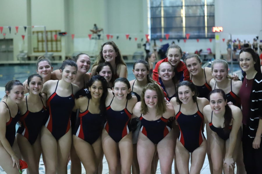 The girls swim team all together after the Rec Plex meet. It's been a long journey for the girls swim team and their support for each other has continued to grow.