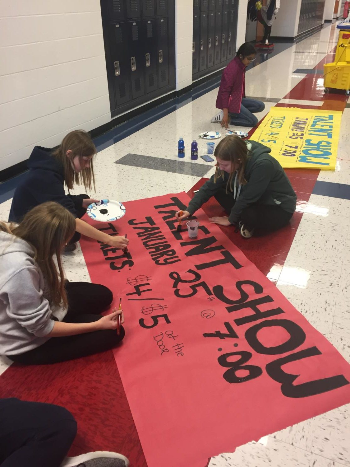 Key Club members create signs to promote the upcoming Talent Show.