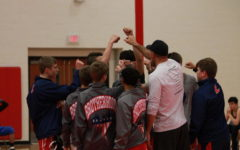 The varsity team huddles before they begin their match against Fort Zumwalt North